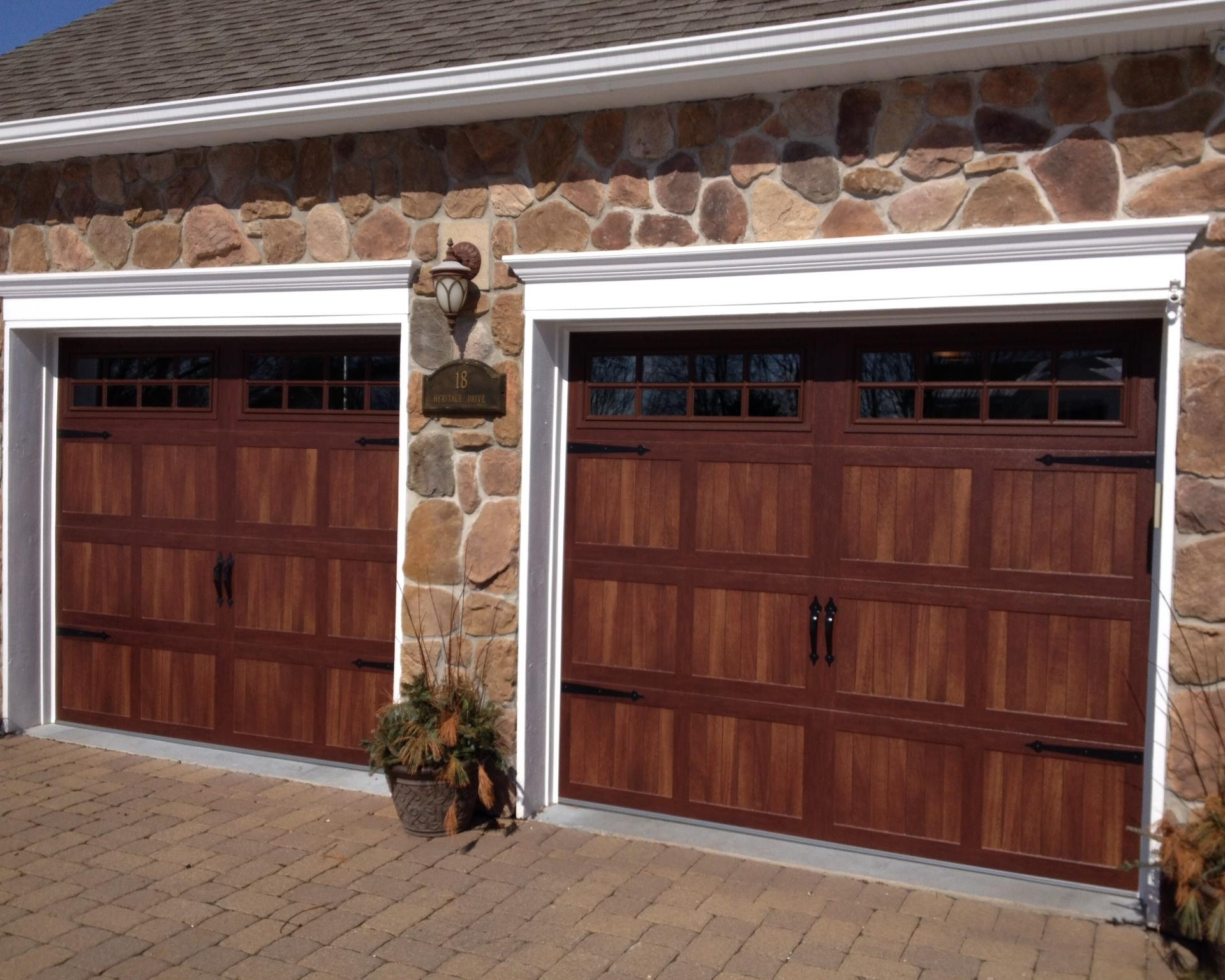 A pair of dark wood garage doors installed by Durable Door.